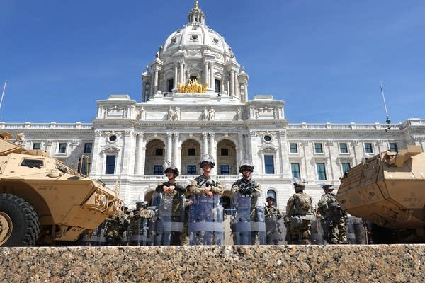 The National Guard surrounds the state Capitol.
