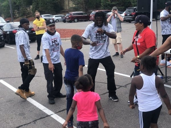 A group of people dance in north Minneapolis.