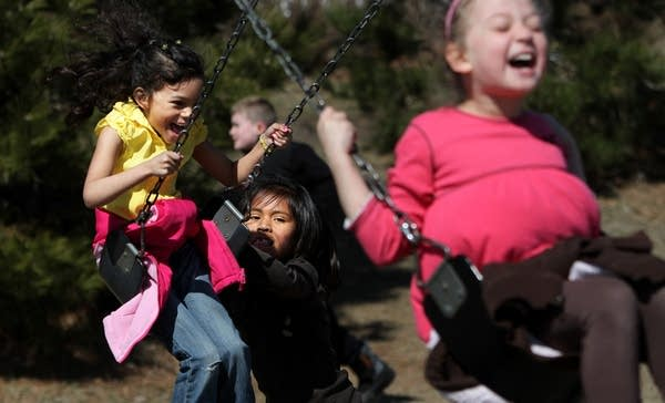 Swinging on playground