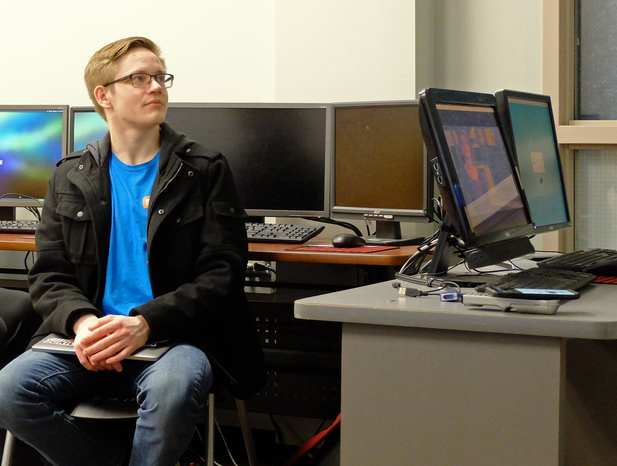 NDSU student Michael Gibbons listens during a cyber security class.