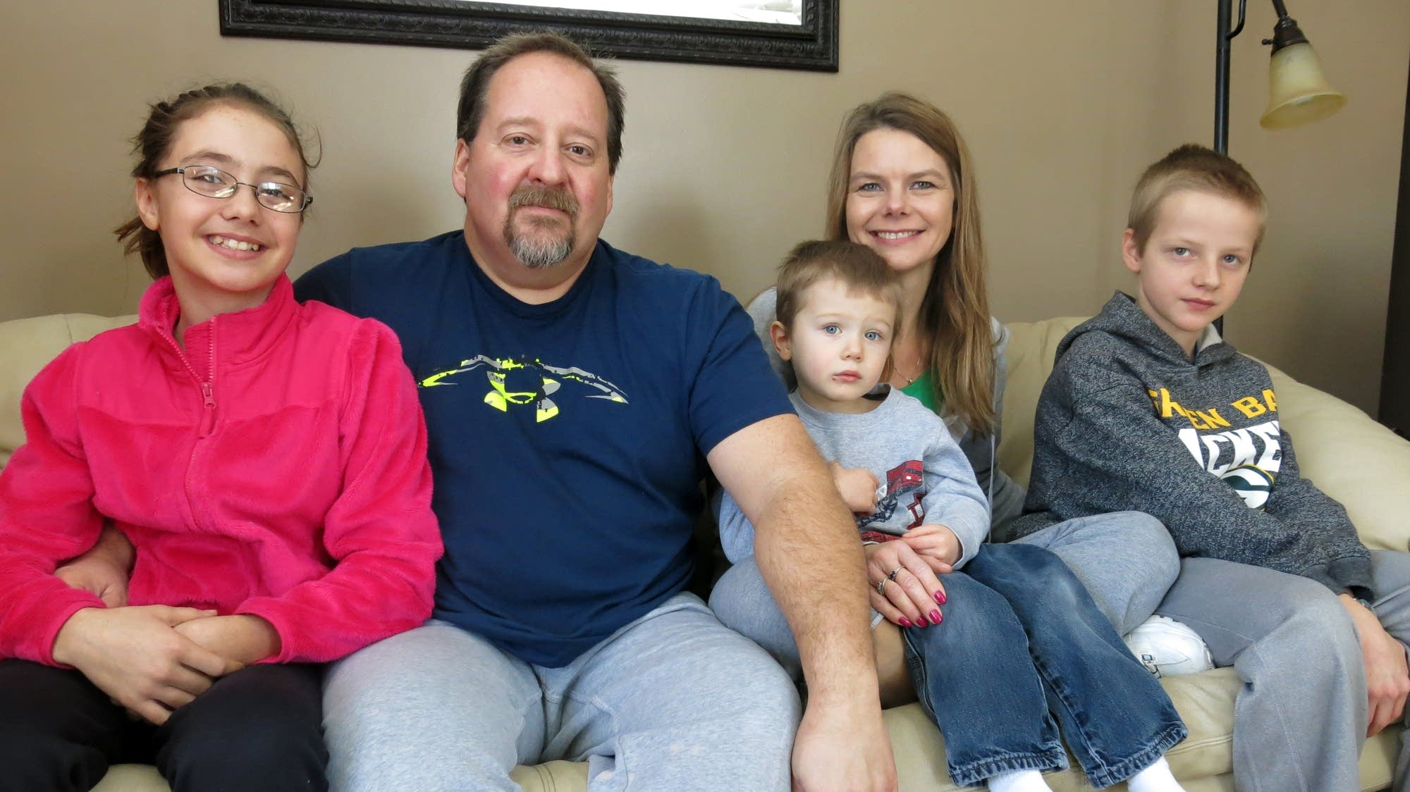 John and Cindy Ness sit with three of their children, Tiena, Zack and Noah.