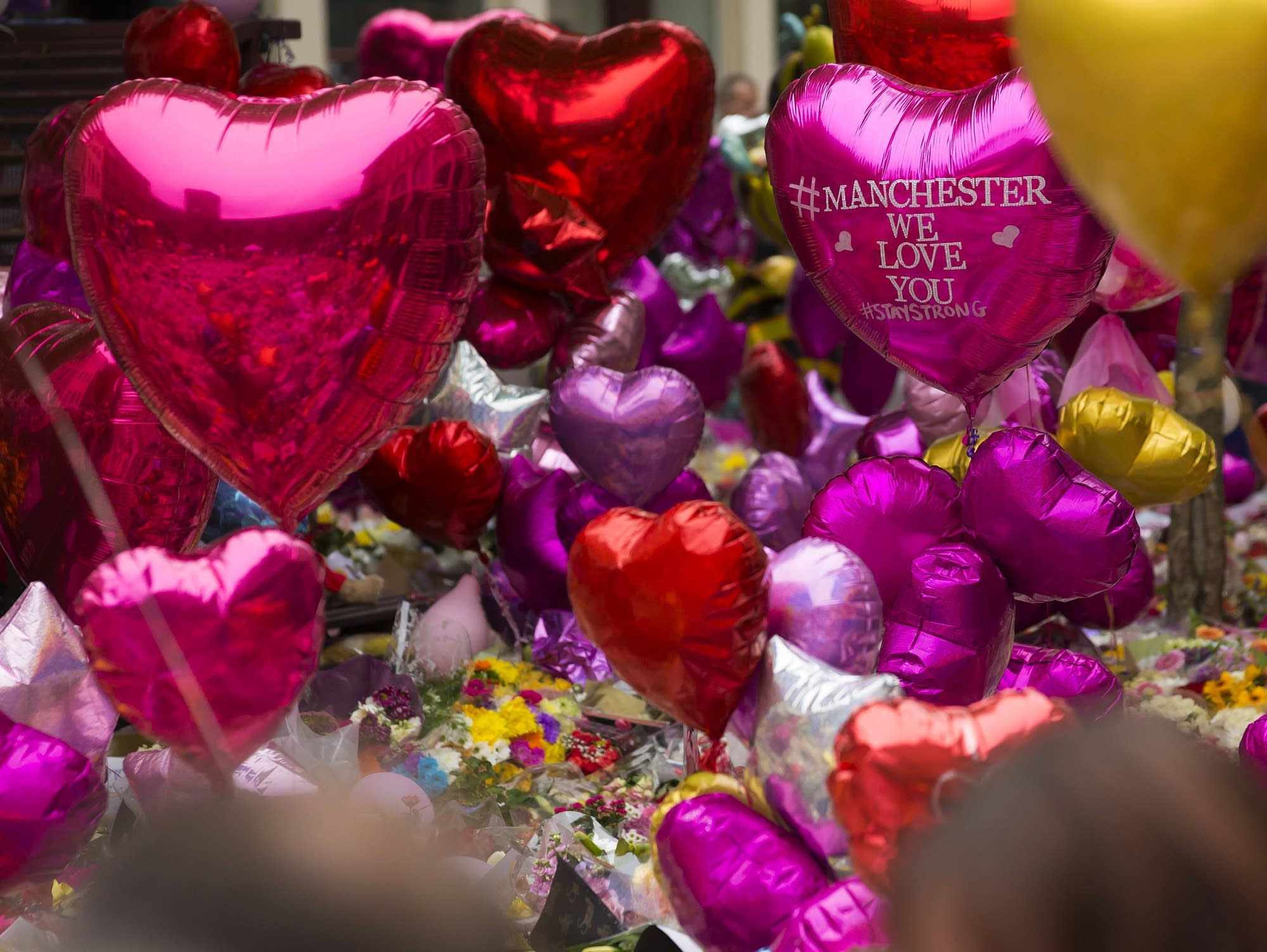 Balloons and floral tributes in St. Ann's Square, Manchester