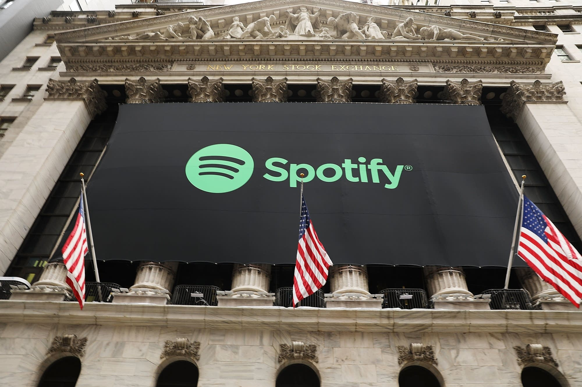 A Spotify banner hangs from the New York Stock Exchange.