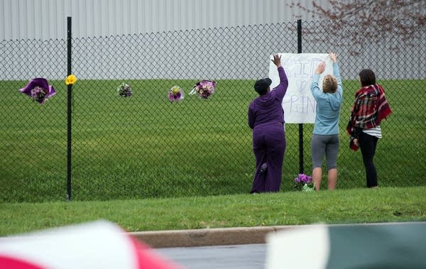 Fans pay tribute to Prince outside Paisley Park.