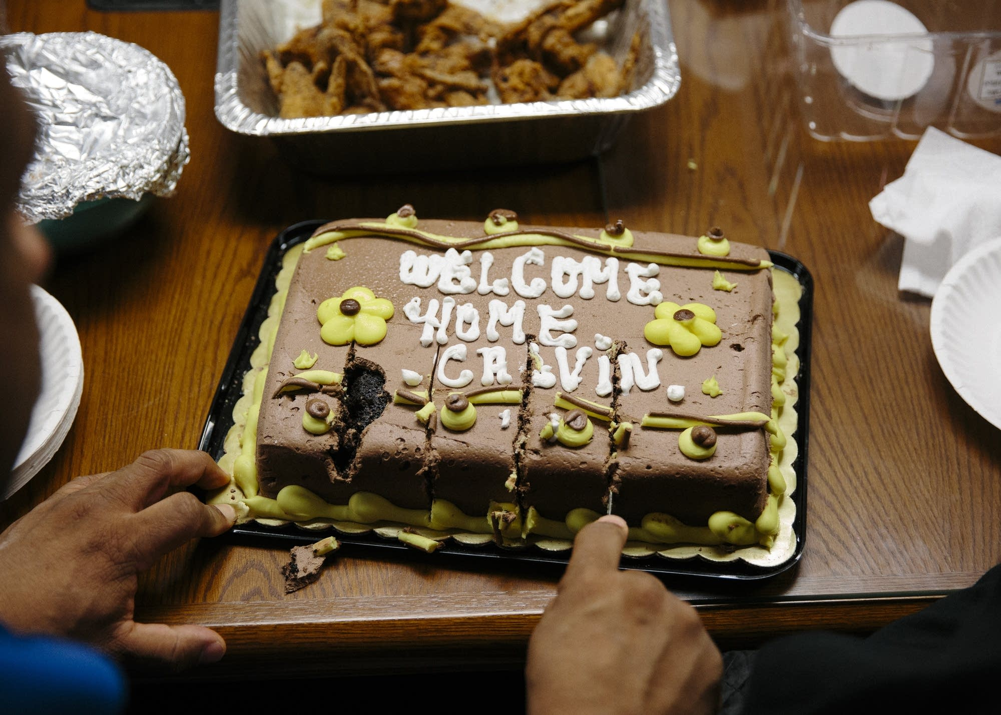 A cake is cut for a new group member.
