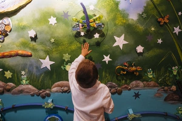 Daniel Christensen plays with an interactive wall.