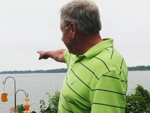 Ron Ruud points to the horizon where turbines may be constructed.