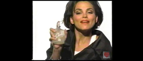 Still shot of 1990s Charlie Perfume commercial ft MTV's Duff holding bottle