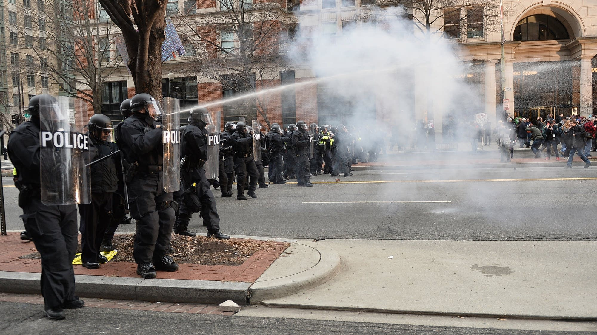 Protesters clash with police after the inauguration.
