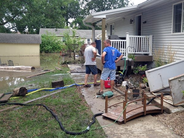 Ron Teslow gets help starting cleanup at his home.