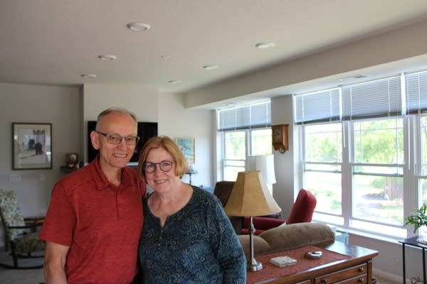 Tom and Sally Kopacek stand in their two-bedroom unit at Applewood Pointe.
