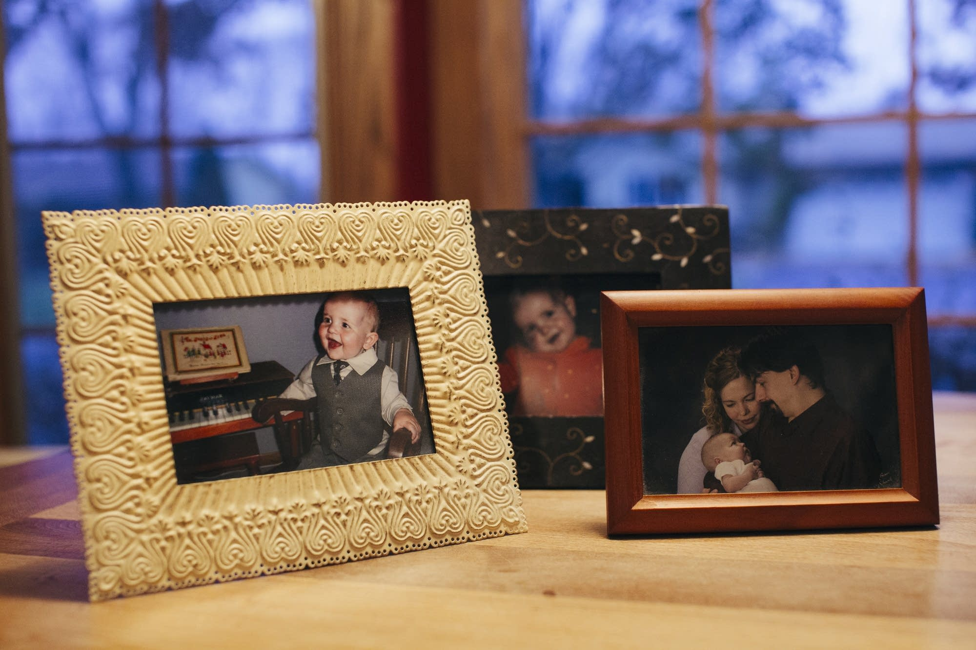 Photos of Ellis Bergstrom sit on his parents' kitchen table.