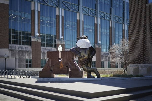 Goldy statue wearing a mask.