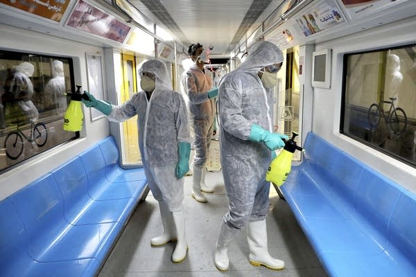 Workers disinfect subway trains against coronavirus in Tehran, Iran.