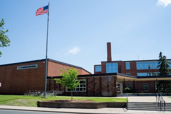 The US flag blows in the breeze outside of St. Louis Park High School