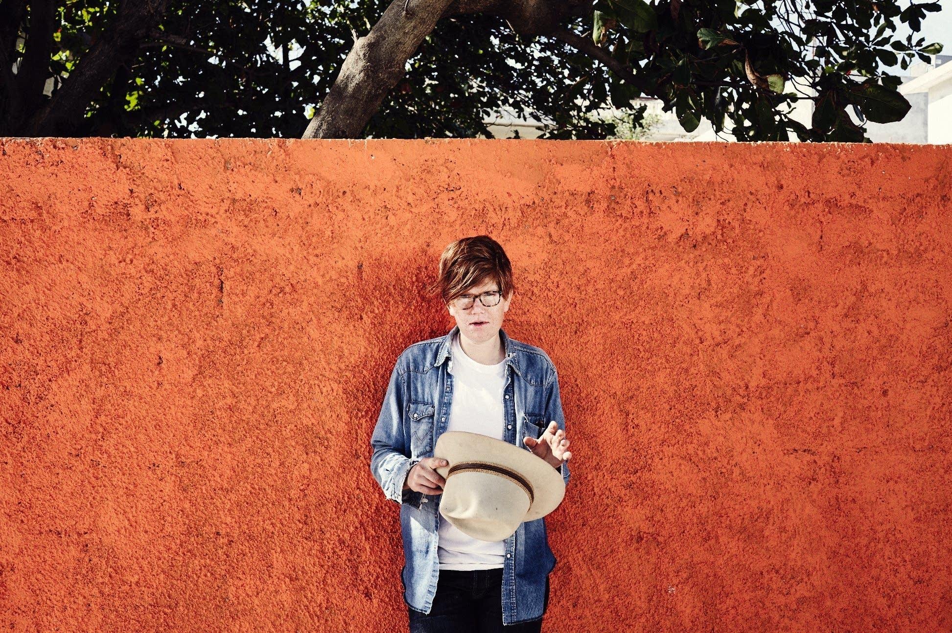 brett dennen hat orange wall