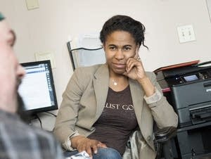 Psychotherapist Anissa Keyes works with a client in her St. Paul office.