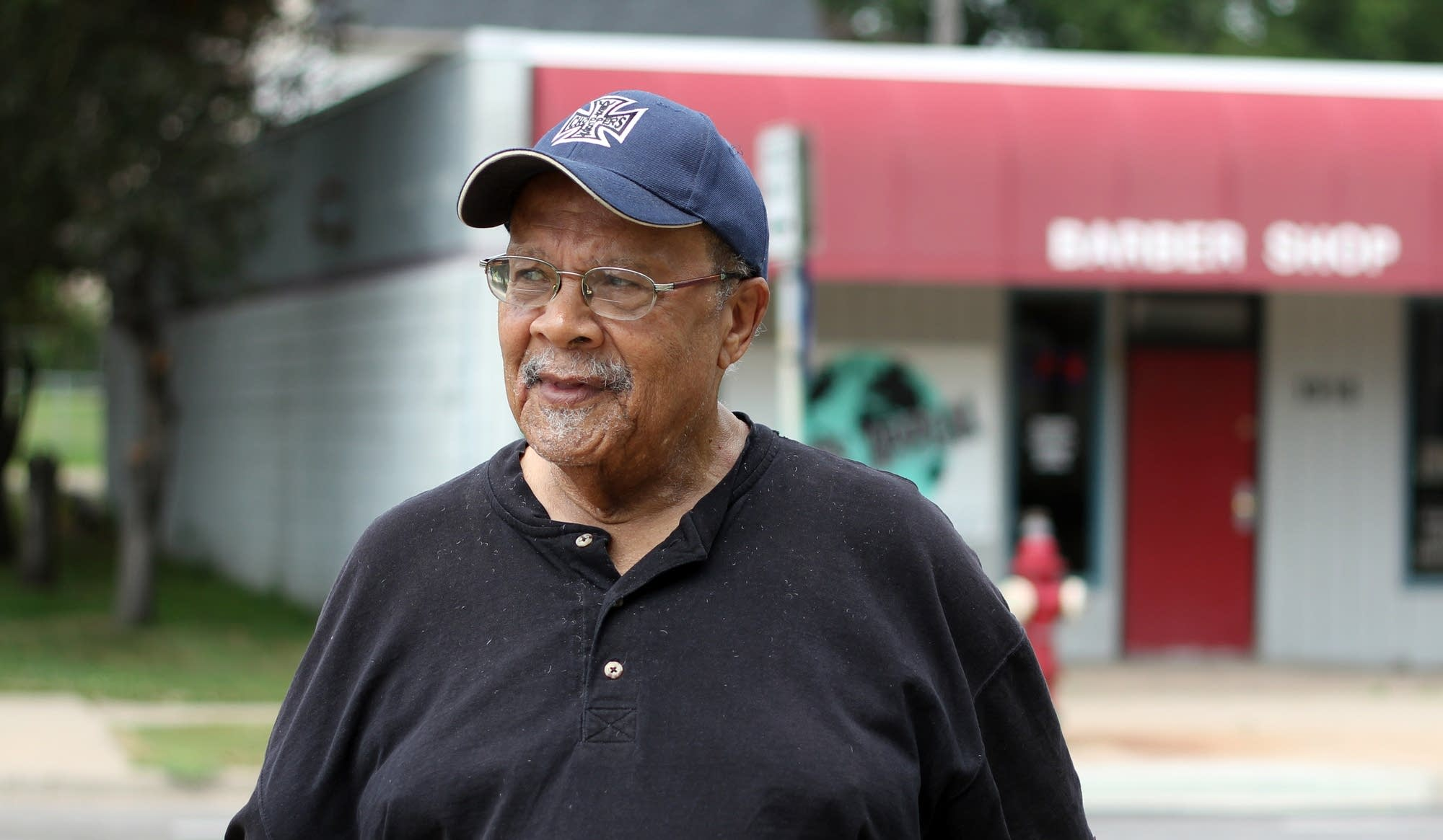 Civil rights activist Ron Edwards stands along a stretch of Plymouth Ave.