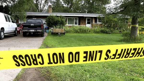 Police tape blocks off a home following a shooting the night before.
