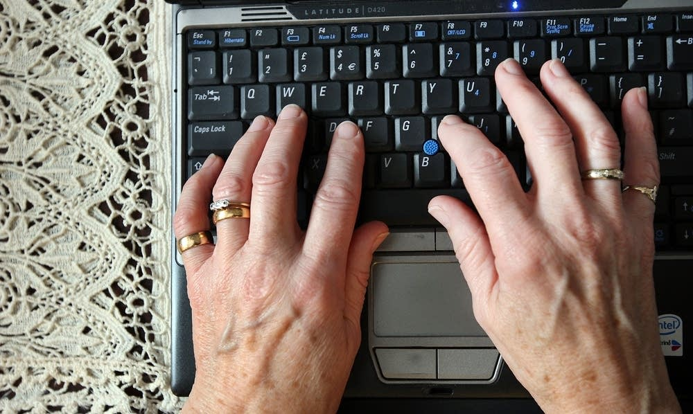 A woman uses a laptop