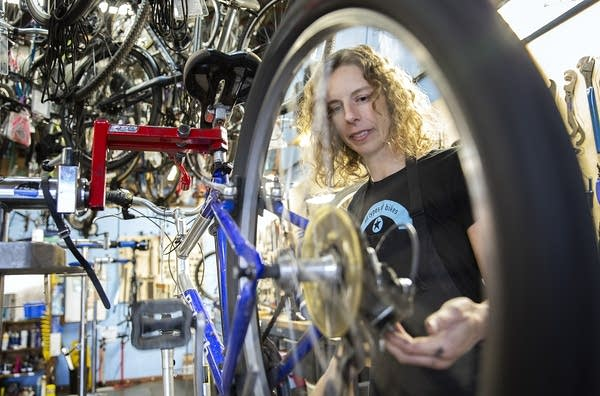 Amber Schmidt works on a bicycle at the Hub Bicycle Cooperative.