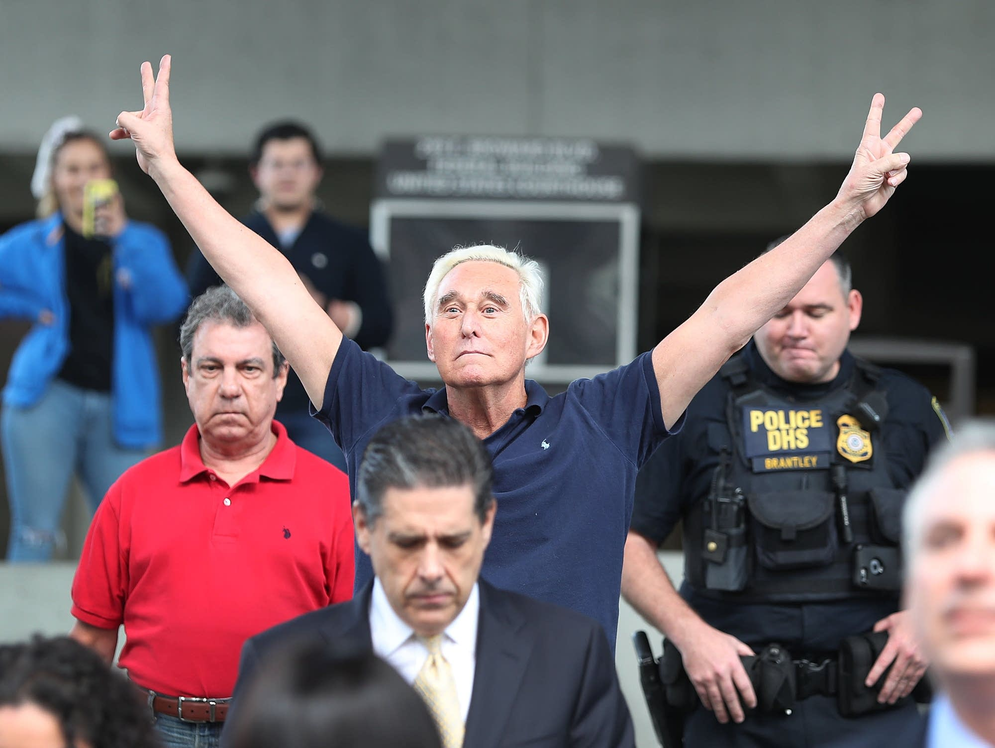 Roger Stone, a confidant to President Trump, exits the federal courthouse