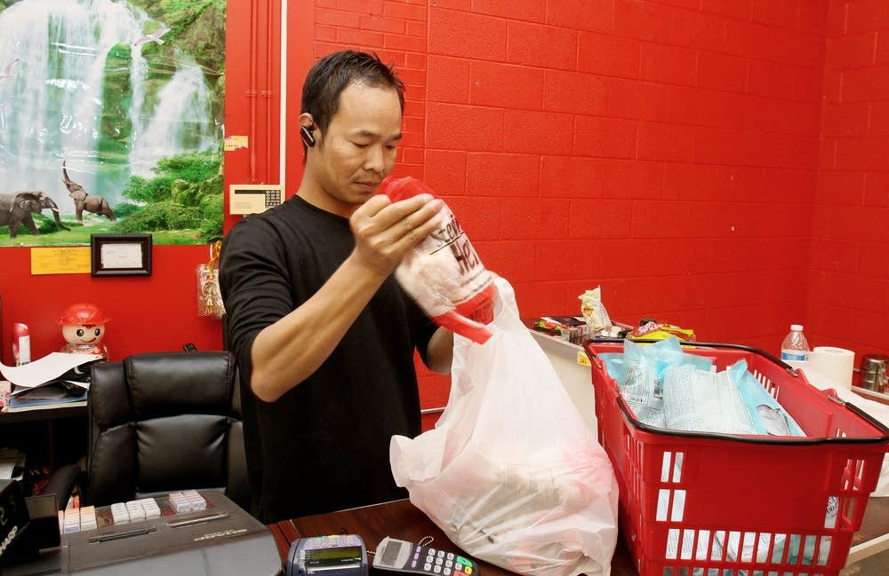 Maung Win bags groceries at Lucky Brothers Market