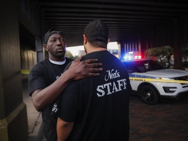 Witnesses comfort one another at the scene of a mass shooting
