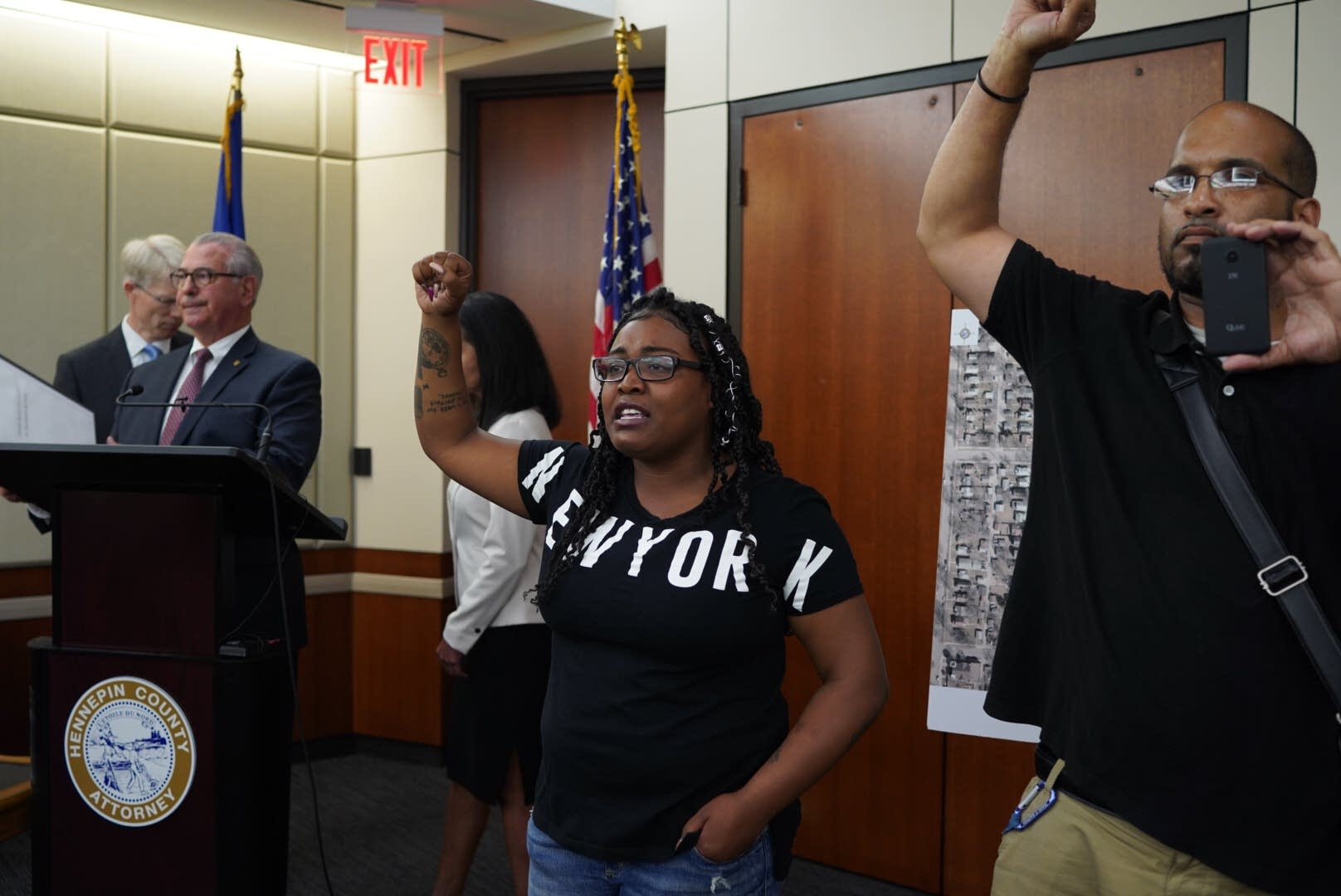 Community members interrupt Mike Freeman's news conference.
