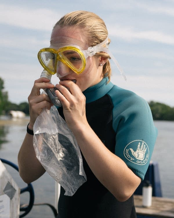 A young woman with a facemask and snorkel.