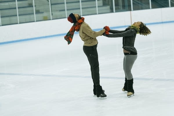 Lee Graham, left, and Carrie Maultsby-Lute spin around each other.