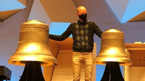 People standing with bells