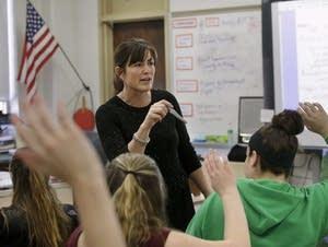 Natalie O'Brien calls on students during a civics class