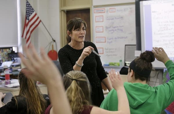 Natalie O'Brien calls on students during a civics class