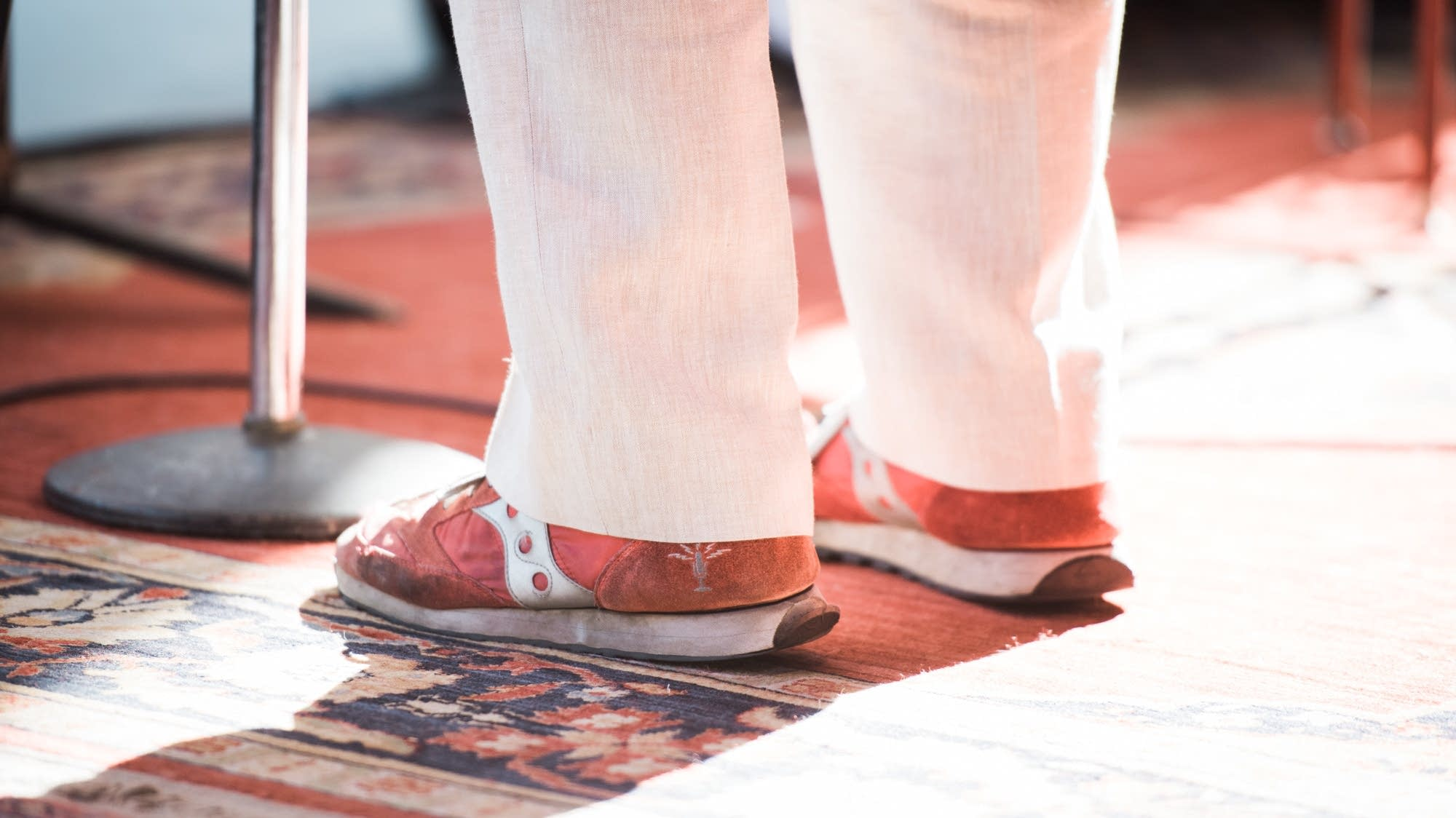 Keillor wears his signature red shoes on stage