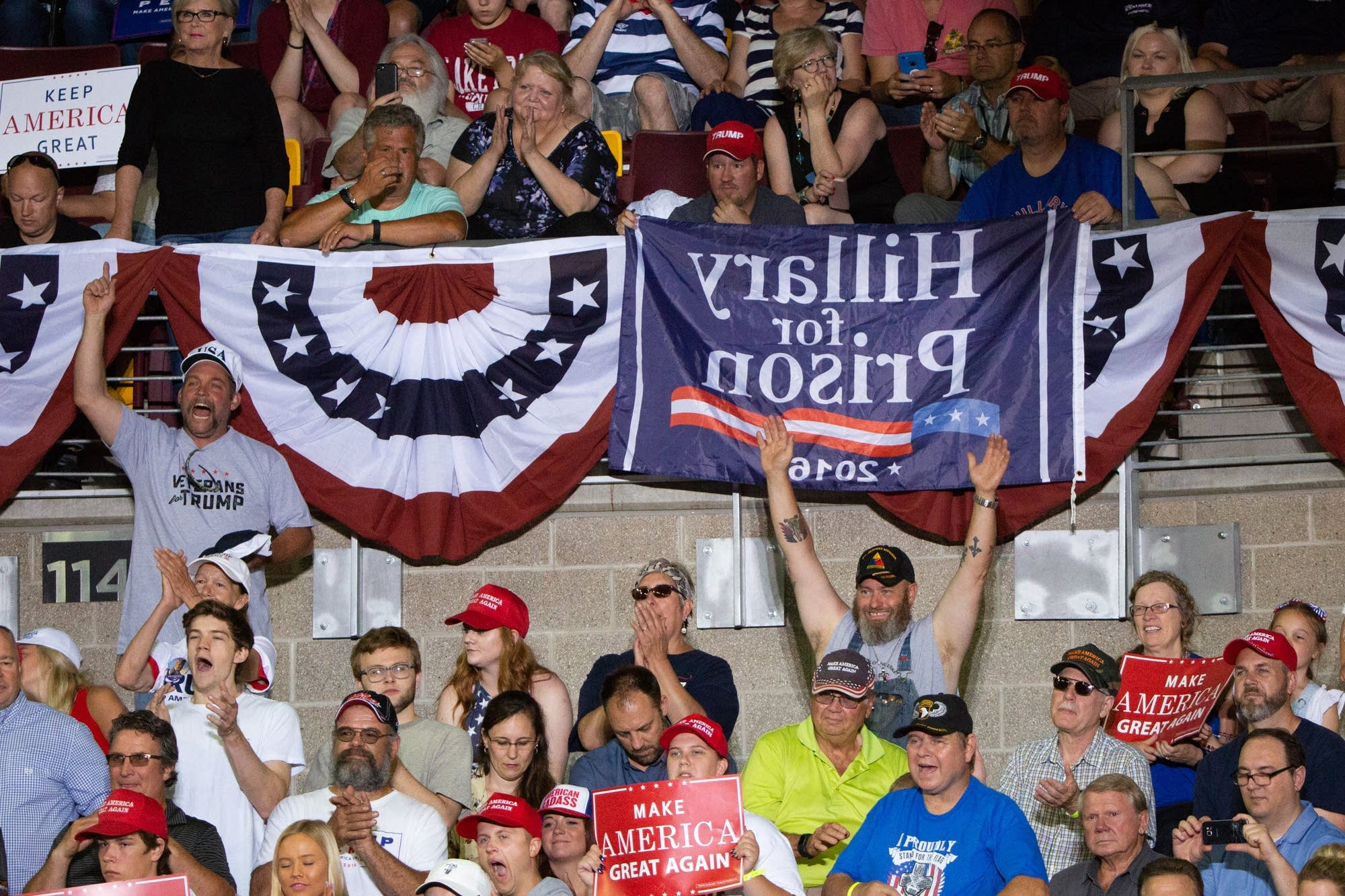 Supporters of President Trump cheer in the stands of Amsoil Arena.