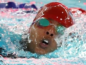 Apollo High School senior Suhan Mohamed competes in the 50-meter freestyle.