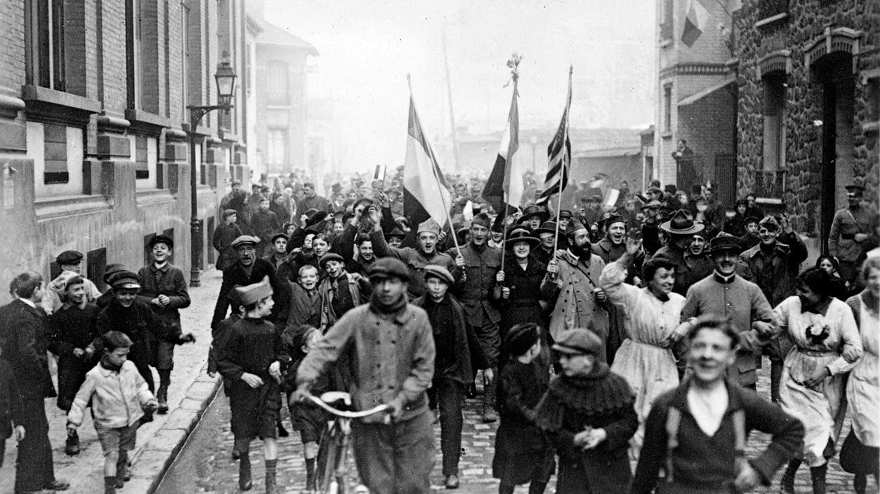 Parisians and Allied troops celebrate the end of World War I in 1918.