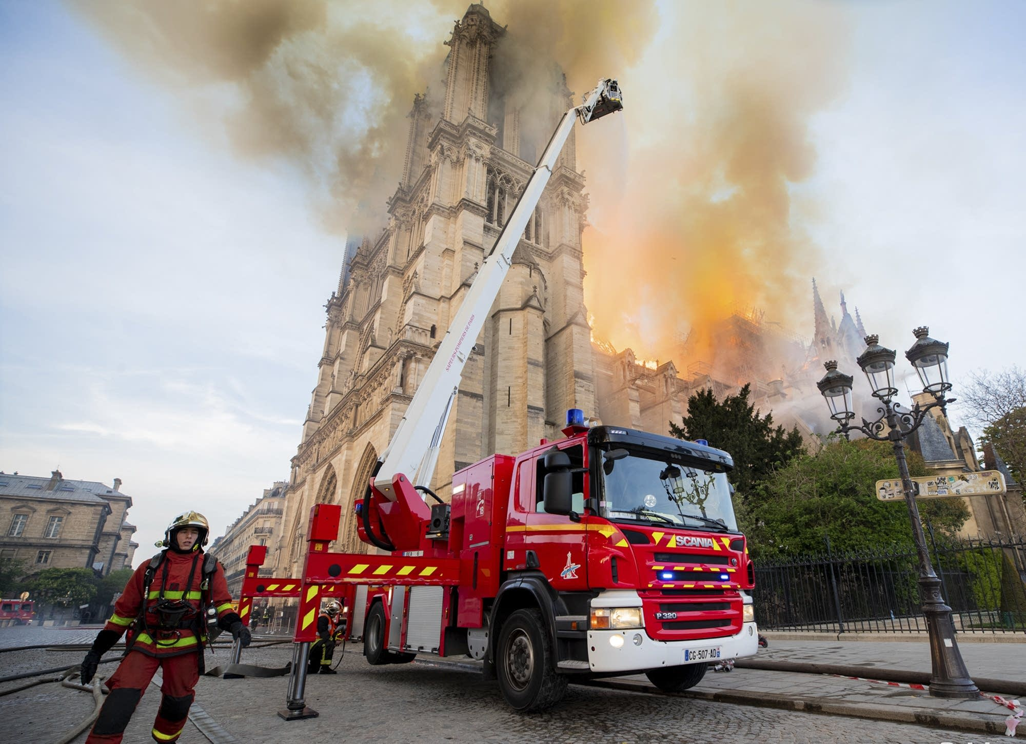 Firefighters work at the burning Notre Dame cathedral.