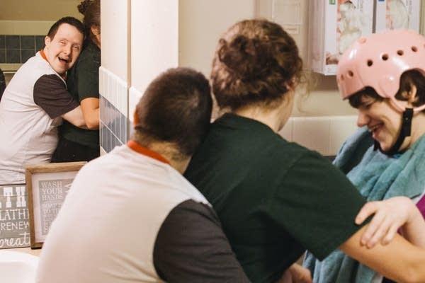 David G. hugs caregiver Jill Tolefson.