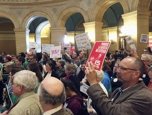 Protesters from labor and other progressive groups fill the rotunda Wed.