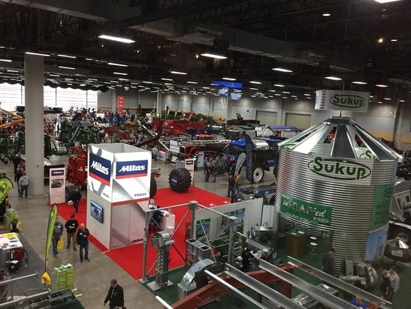 Farmers attend a major farm equipment show in Des Moines, Iowa.