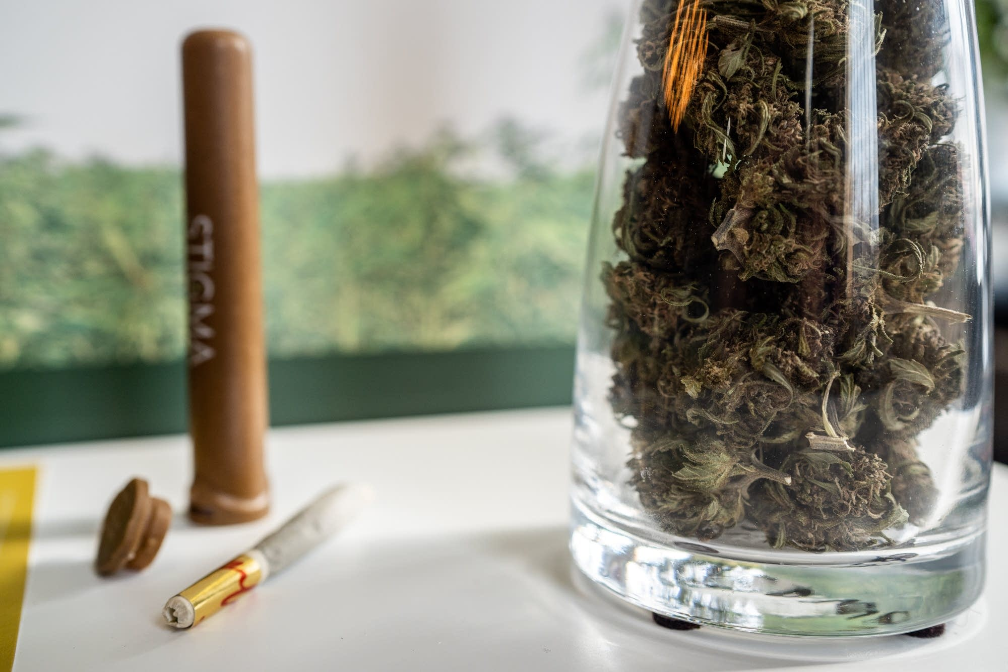 A jar of hemp sits next to a 1-gram