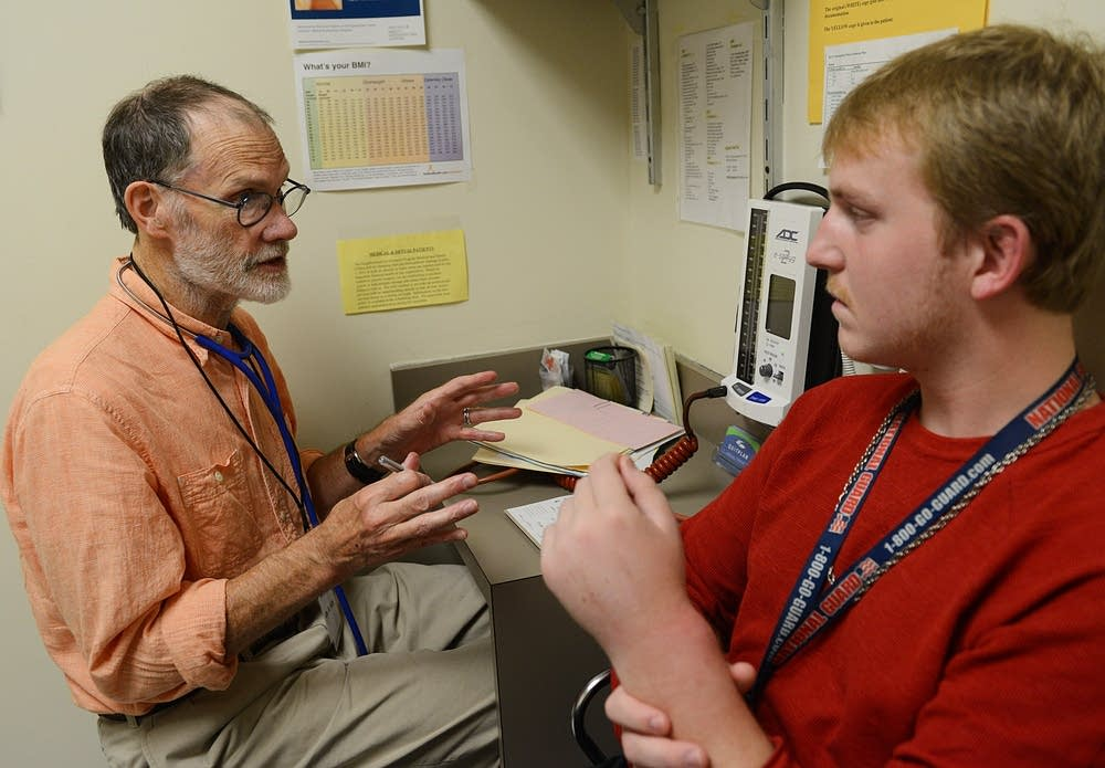 Dr. Robert Aby describes the prescription to patient.