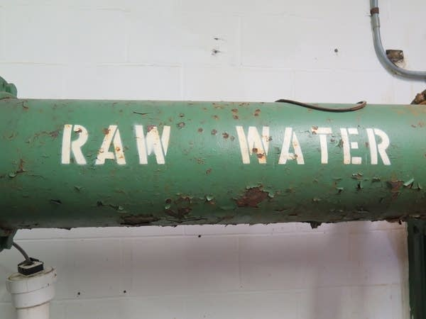 A pipe carries raw water into the old city water treatment plant.