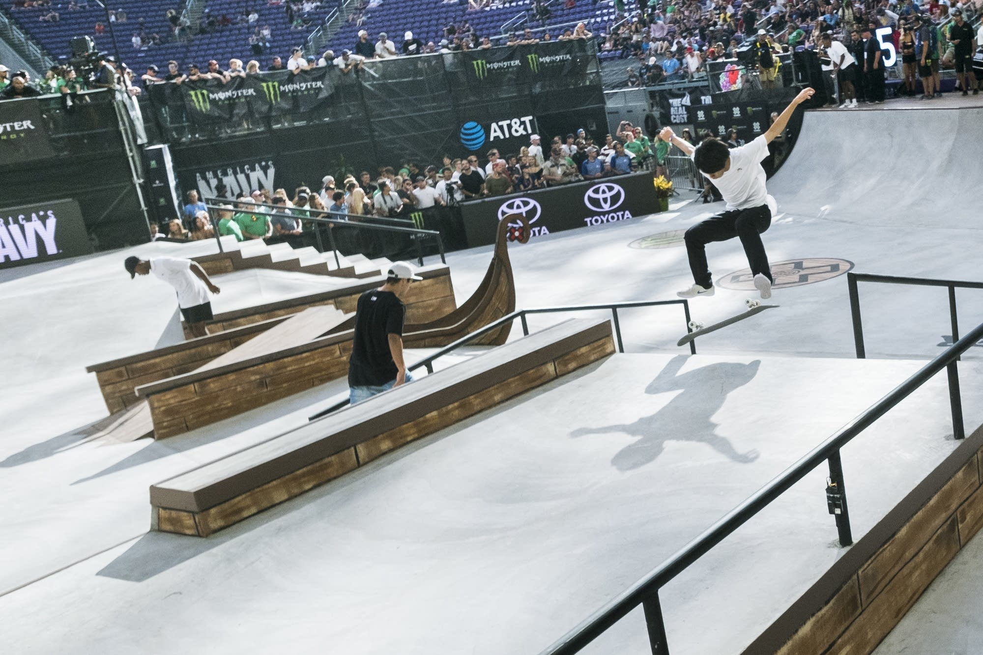 Yuto Horigome throws a flip off of a ramp during warm ups.