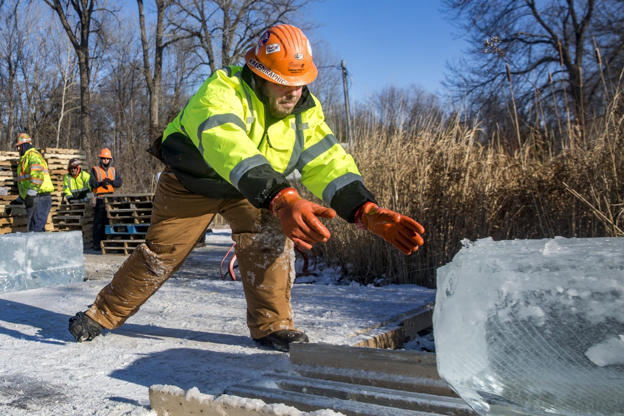 A Park Construction worker receives a block of ice.