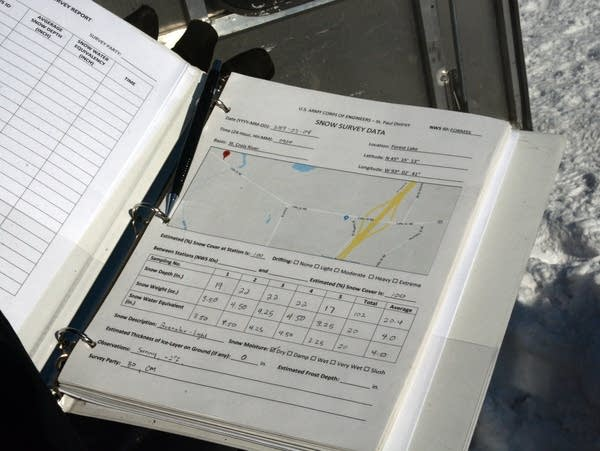 Bill Odell holds the binder he uses to record snow sample information.