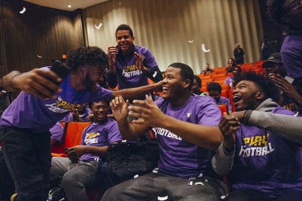 North High School football players react to a surprise.