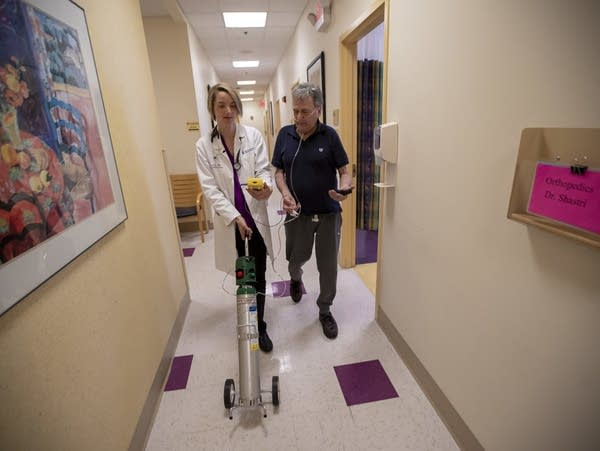 Dr. Mary Rice walks with Michael Howard